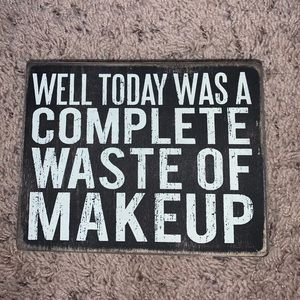 "box sign - ""waste of makeup"""